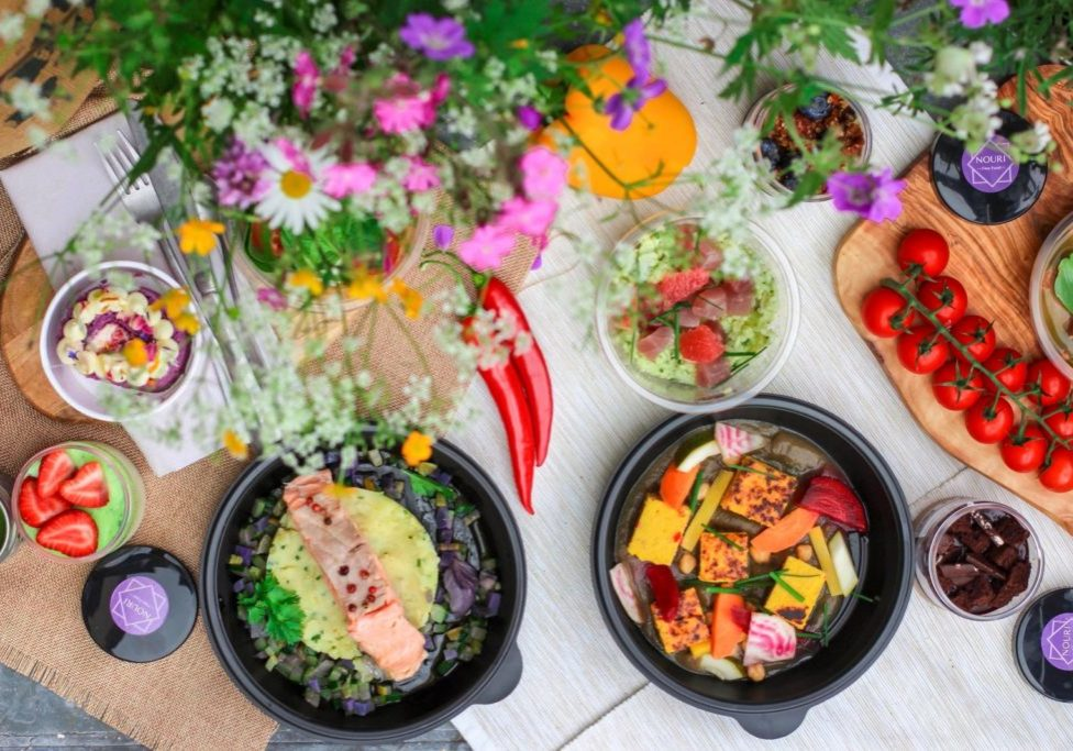 colorful table with fruits, veggies and flowers