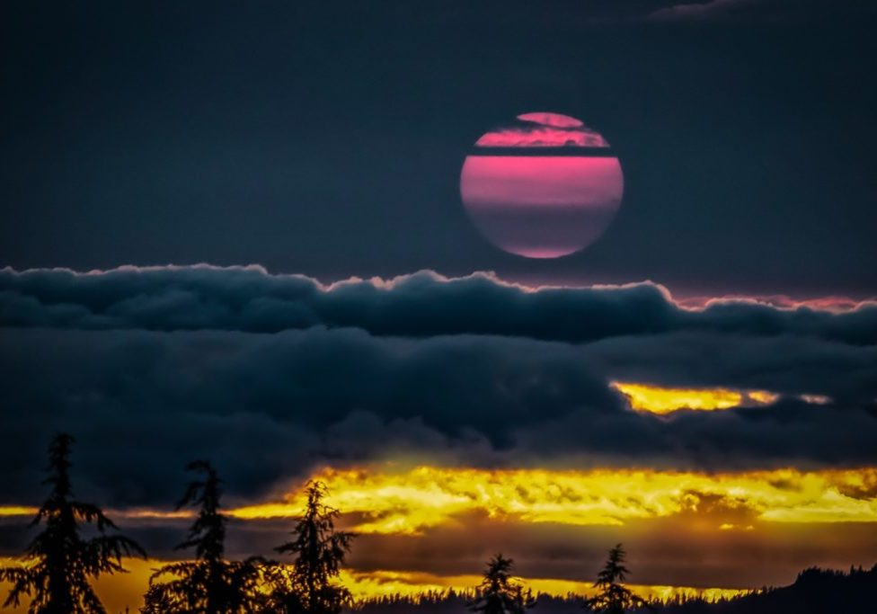 sunset with purple sun and yellow light