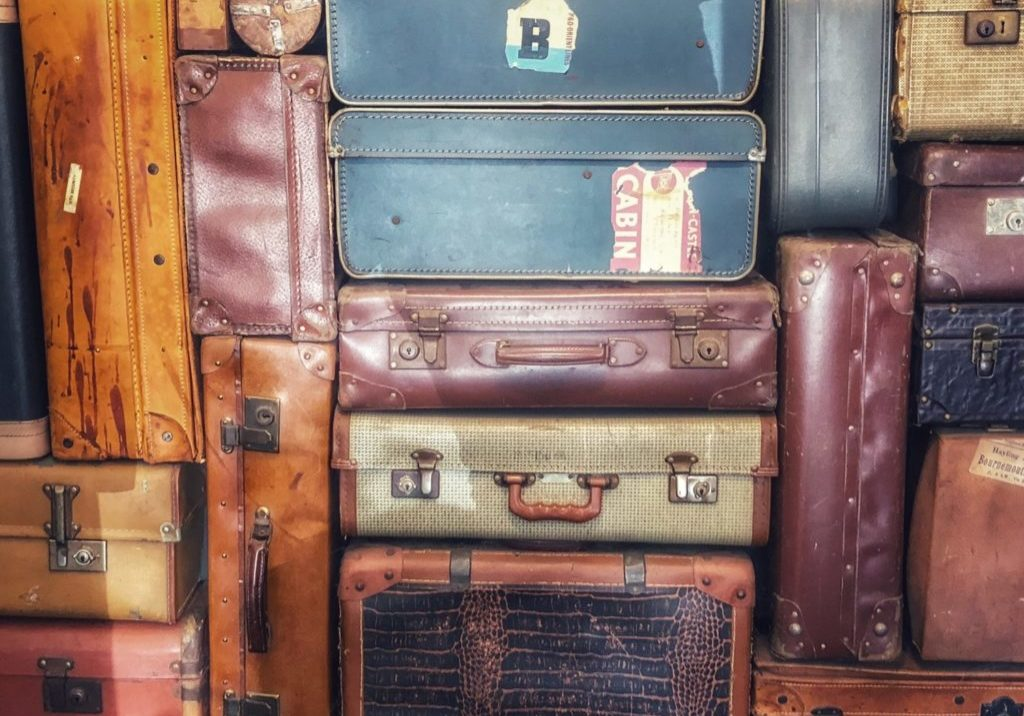 colorful suitcases stacked up high